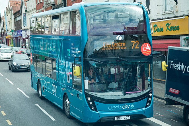 Electric Bus traveling down Gloucester Road, Bristol