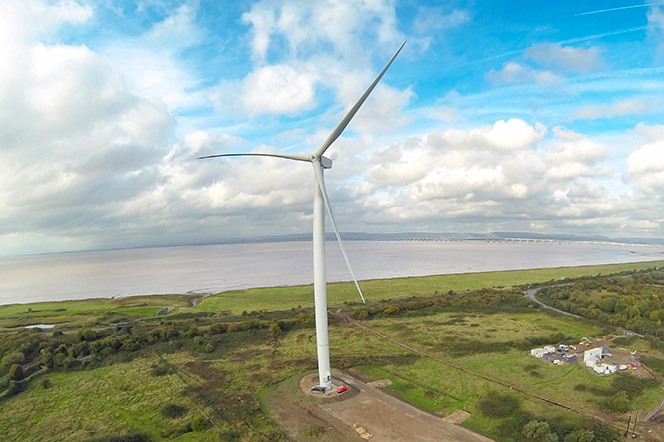 Avonmouth wind turbine with the River Severn and bridge in the distance