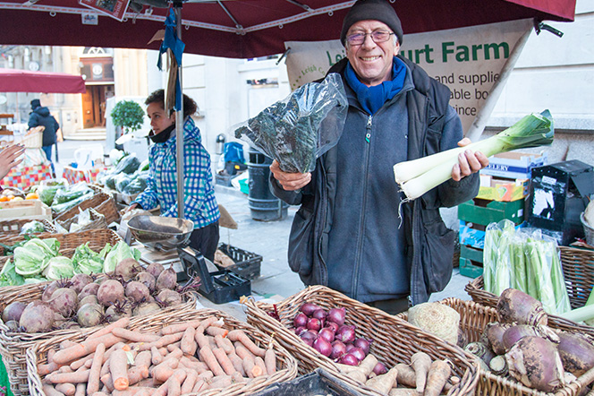 St Nics Market Farmer holding up fresh produce