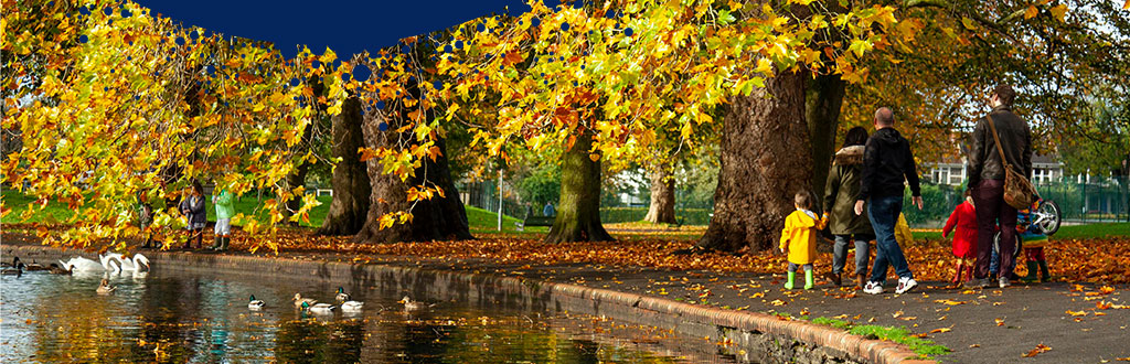 Eastville Park Lake with Autumn leaves on trees