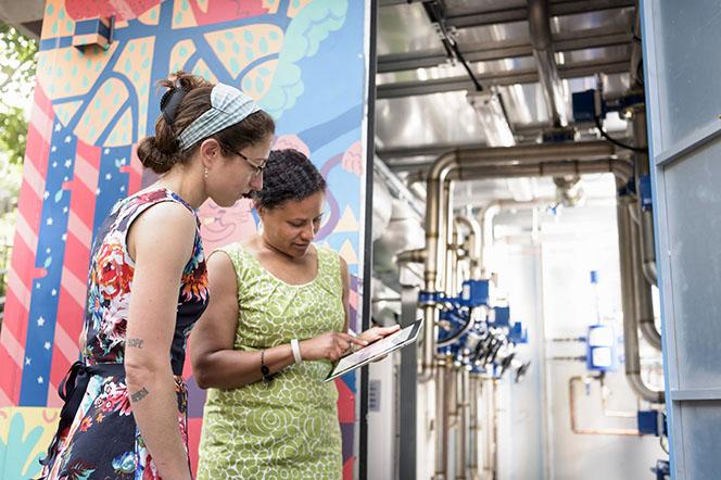 Community staff looking at energy saving ideas on ipad.