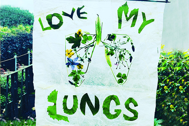 """Hand crafted banner with illustration of lungs and the message """"Love My Lungs"""" made from green leaves."""